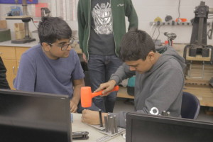 Robot Manager Aamhish and Vibhu working on the Cougar Claw intake